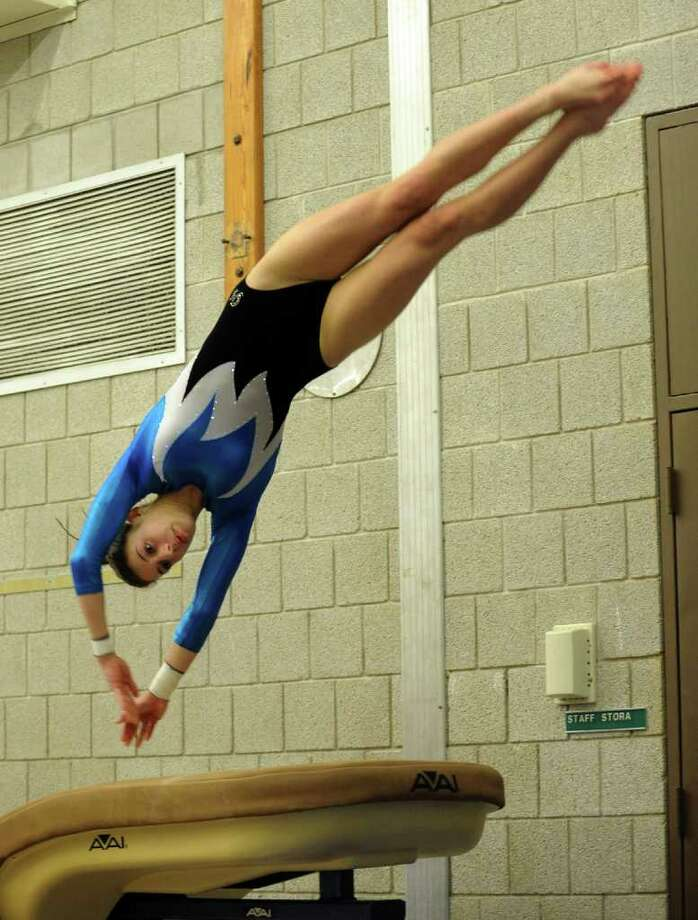 Staples' Anna Violette competes on the vault table, during a gymnastics meet against Pomperaug and Nonnewaug at Weston Middle School in Weston, Conn. on Friday January 14, 2011. Photo: Christian Abraham / Connecticut Post
