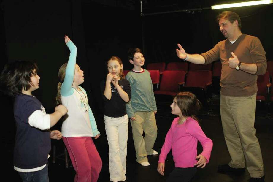 Jim Schilling, co-founder of the Music Theatre of Connecticut in Westport, teaches a class of students recently. The MTC is one of about a dozen theater schools in the region catering to students of various ages. Photo: Contributed Photo / Connecticut Post Contributed