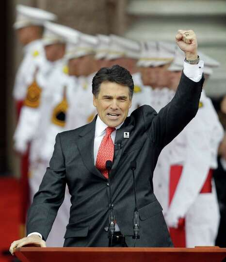 Gov. Rick Perry pumps his fist during a speech at his inauguration, Jan. 18, 2011, in Austin.