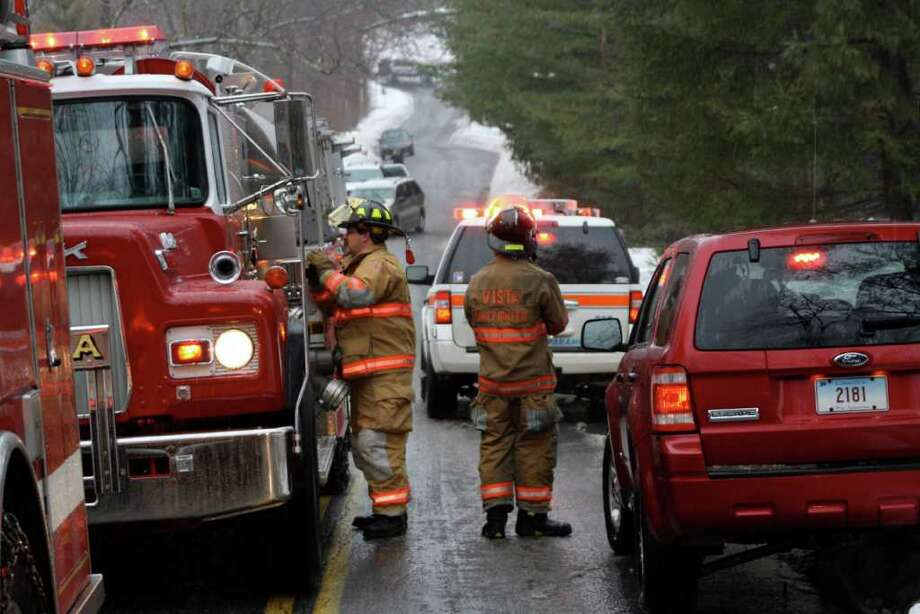 Firefighters, police, and emergency personnel responded to Puddin Hill Road for a structure fire at the Center of Bioenergetic Analysis Tuesday afternoon. Photo: Contributed Photo / New Canaan News