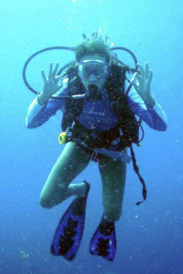 Greenwich resident Allegra Rumbough gives the OK sign while scuba diving in waters off Cape Eleuthera in the Bahamas. Rumbough spent a semester on Cape Eleuthera at The Island School. Photo: Contributed Photo / Greenwich Citizen