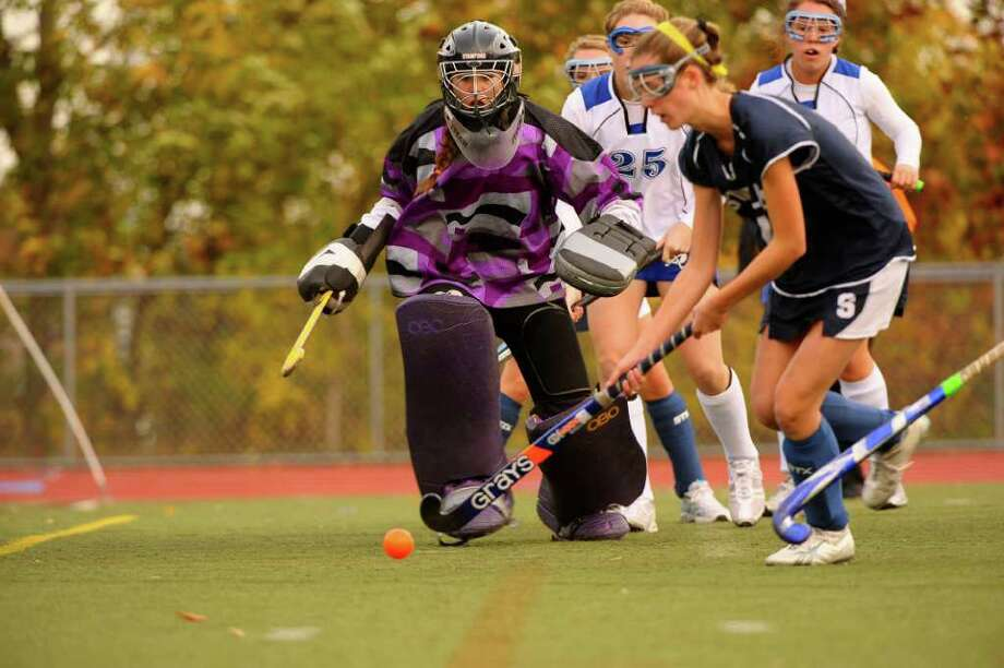 Staples senior tri-captain Jen Hoets makes a kick save and was the team's Defensive MVP. Hoets will be playing for St. Lawrence University next year. Photo: RONALD W. HINER, Contributed Photo / Ronald W. Hiner / (C) 2010 RONALD W. HINER