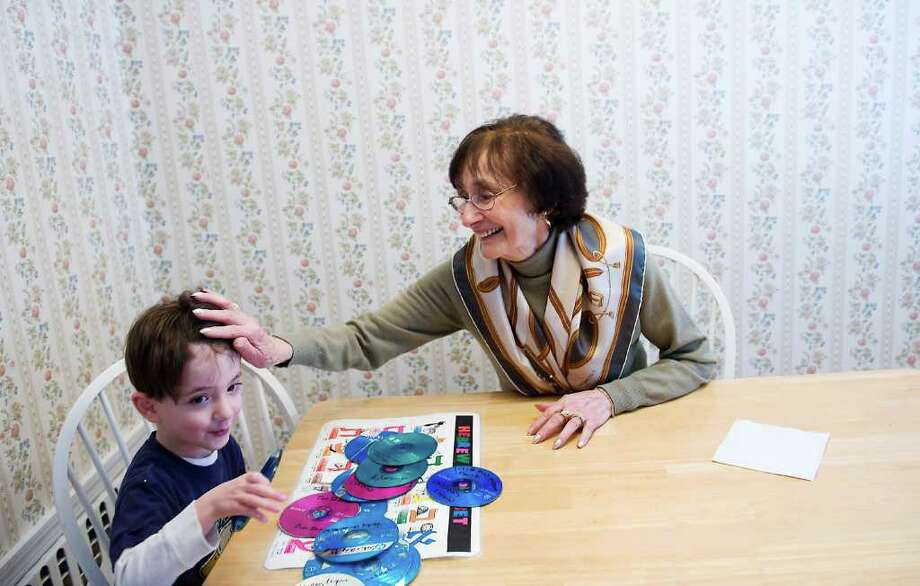 Marge Shameer spends a moment with her grandson Alex Cohen, 3, at their home in Stamford, Conn. on Tuesday January 18, 2011. Marge was born in Berlin and her father spent 7 months in a German concentration camp. Photo: Kathleen O'Rourke / Stamford Advocate