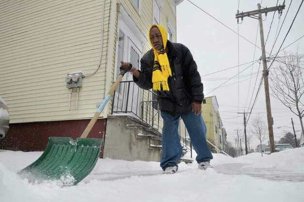 D W Dantzler clears the snow off the sidewalk outside his home in Albany on Tuesday, Jan. 18, 2011.  (Paul Buckowski / Times Union) Photo: Paul Buckowski / 10011776A