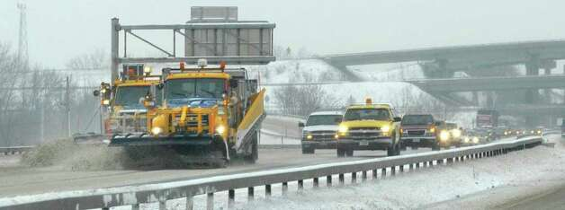 A pair of New York State DOT snowplows clear snow off of the southbound lanes of Interstate 787 in Albanyon Tuesday, Jan. 18, 2011.   (Paul Buckowski / Times Union) Photo: Paul Buckowski / 10011776A