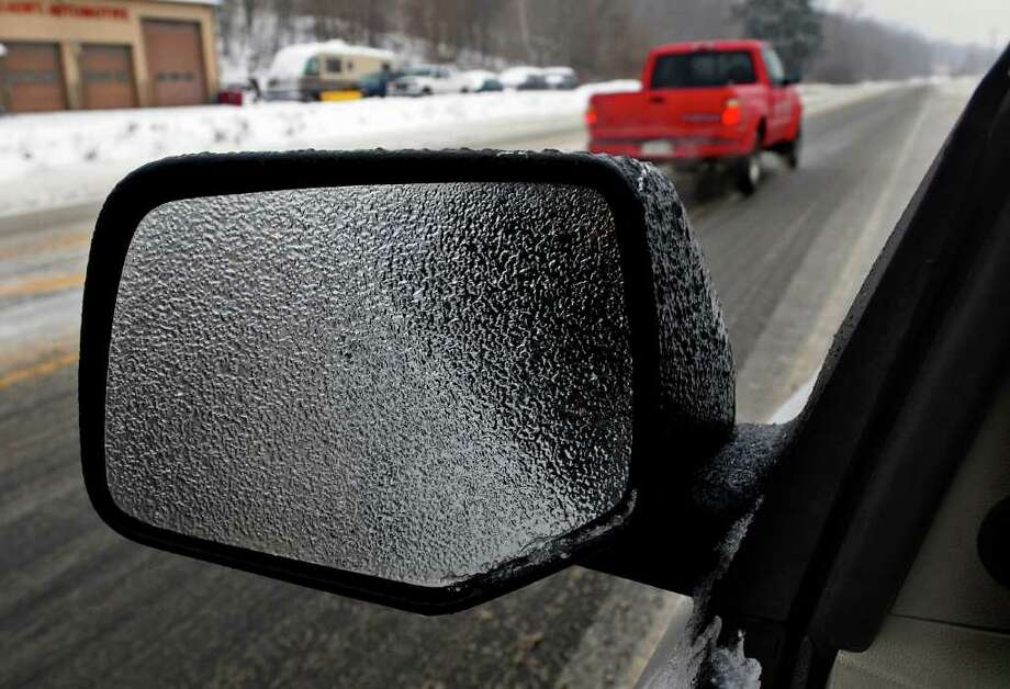 A side view mirror is iced over on Route 9W in New Baltimore during Tuesday's storm. ( Philip Kamrass / Times Union ) Photo: Philip Kamrass