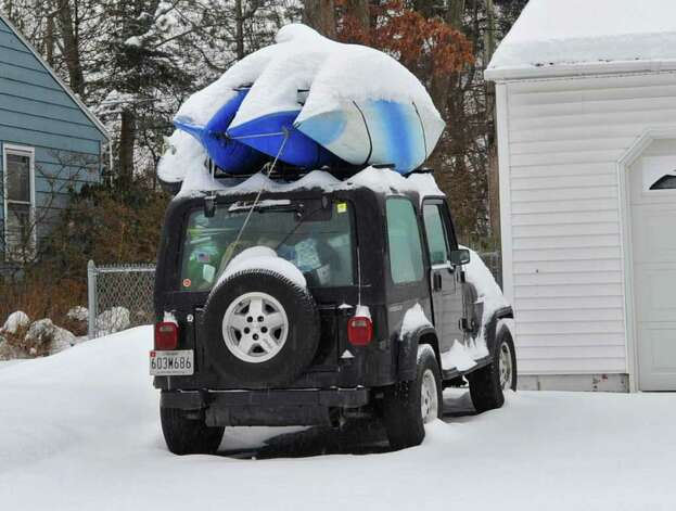 Three kayaks on top of a car are covered in snow and ice in Colonie Tuesday.  (Lori Van Buren / Times Union) Photo: Lori Van Buren