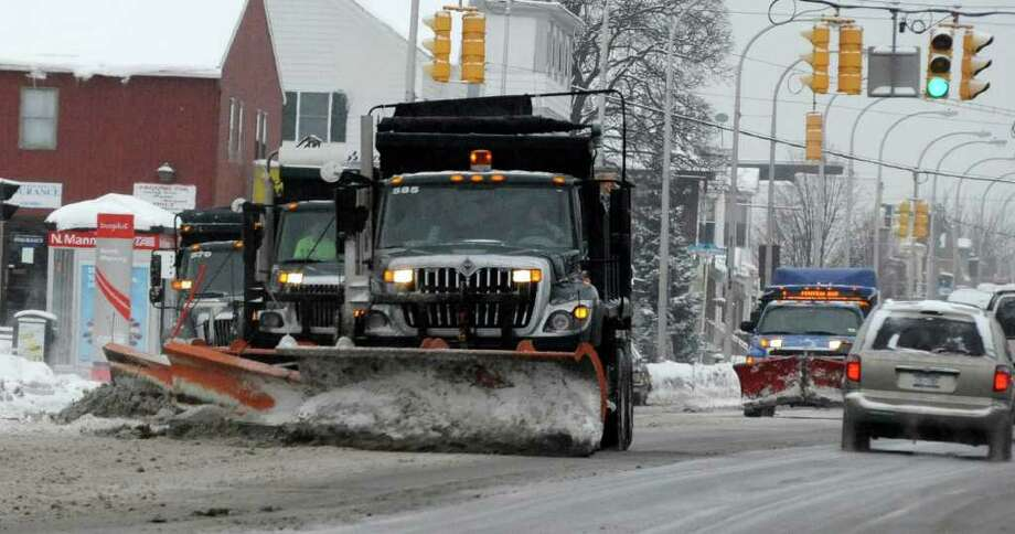 Snow plows move the slush from Central Avenue in Albany Tuesday. (Skip Dickstein / Times Union) Photo: Skip Dickstein / 2008