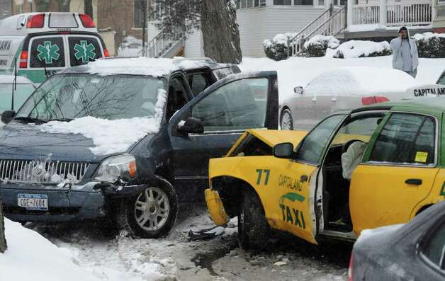 A cab and a mini van collided at the intersection of Morris Street and South Lake Avenue in Albany this Tuesday afternoon.  (Skip Dickstein / Times Union) Photo: Skip Dickstein / 2011
