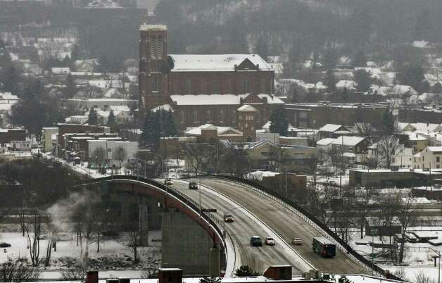 Traffic crosses the Congress Street Bridge into Troy, NY during Tuesday's storm as seen from Prospect Park. Watervliet is visible in the background. ( Philip Kamrass / Times Union ) Photo: Philip Kamrass