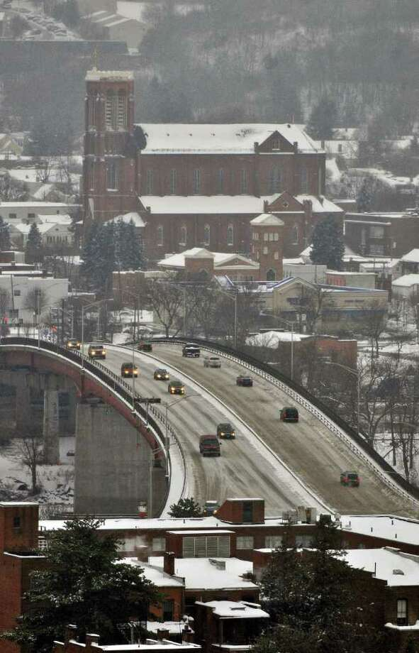 Traffic crosses the Congress Street Bridge into Troy during Tuesday's storm as seen from Prospect Park. Watervliet is visible in the background. ( Philip Kamrass / Times Union ) Photo: Philip Kamrass