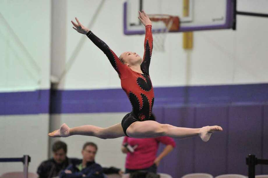 Greenwich gymnast Ashlyn Wah, 11, won the all-around title at the the USA Gymnastics State Championships last month. Photo: John Cheng_                         , Contributed Photo