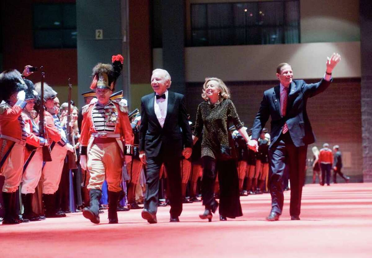 Democratic Senators Joseph Lieberman and Richard Blumental walk the red carpet with Lieberman's wife Hadassah at the 2011 Inaugural Ball at the Connecticut Convention Center in Hartford, Conn., Wednesday evening, January 5, 2011. The ball is hosted by the Board of Trustees of the First Company Governor's Foot Guard.