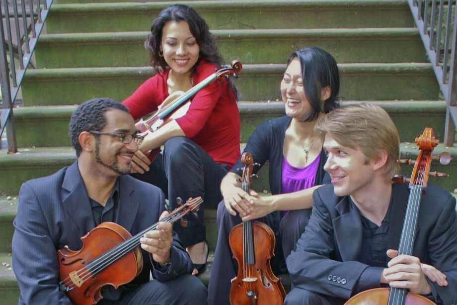 """To the Stars and Back"" will featue Music Haven, a string quartet, accompanied by a star show at the Henry B. duPont III Planetarium at Bridgeport's Discovery Museum on Saturday, beginning at 6:30 p.m. Photo: CONTRIBUTED PHOTO"