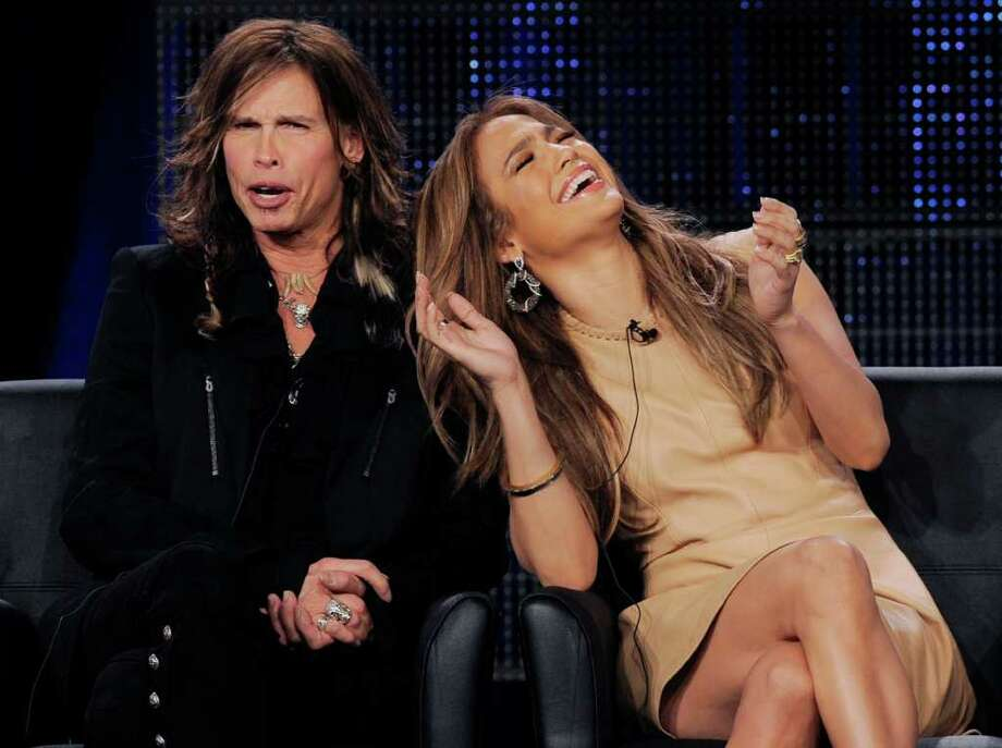 "Steven Tyler, left, and Jennifer Lopez, new judges on the FOX series ""American Idol,"" react during a panel discussion on the show at the FOX Broadcasting Company Television Critics Association winter press tour in Pasadena, Calif., Tuesday, Jan. 11, 2011. (AP Photo/Chris Pizzello) Photo: Chris Pizzello, STF / AP"