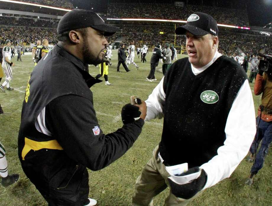 New York Jets coach Rex Ryan, right, and Pittsburgh Steelers coach Mike Tomlin meet after the Jets' 22-17 win in an NFL football game in Pittsburgh, Sunday, Dec. 19, 2010. (AP Photo/Gene J. Puskar) Photo: AP