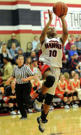 HJ's Diamond Turner goes up for a basket unchallenged by Orangefield at Hardin-Jefferson High School