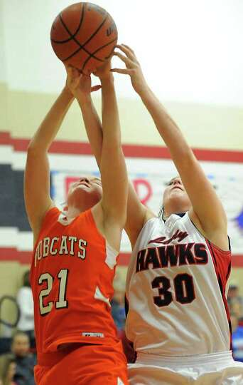 Orangefield's Kasidy Hayes and HJ's Sharadan Priddy battle for the rebound at Hardin-Jefferson High