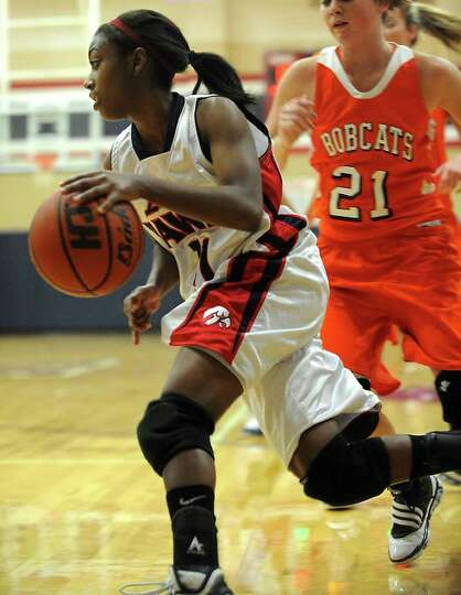HJ's Robbie Saunders drives to the basket during the game against Orangefield at Hardin-Jefferson Hi