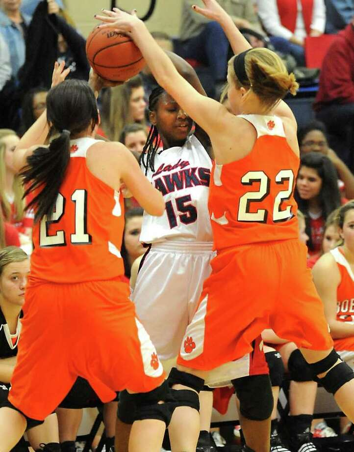 HJ's Kesha Broussard is double teamed by Orangefield's Kassidy Hayes and Morgan Moss at Hardin-Jefferson High School in Sour Lake, Tuesday. Tammy McKinley/The Enterprise Photo: TAMMY MCKINLEY / Beaumont
