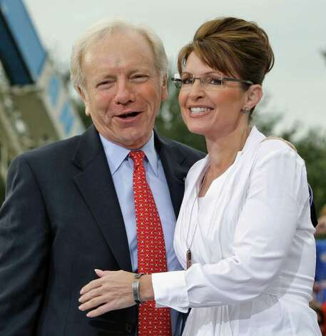 Republican vice-presidential candidate, Gov. Sarah Palin, right, gets a hug from  Sen. Joe Lieberman, I-Conn., before a campaign speech Monday morning Oct. 6, 2008 in Clearwater, Fla. (AP Photo/Chris O'Meara) Photo: Chris O'Meara, AP / AP