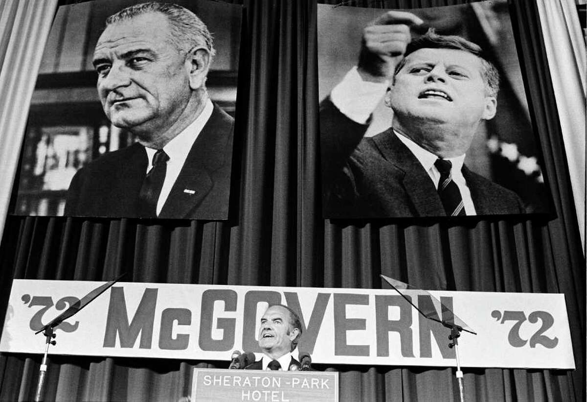 With the pictures of former democratic presidents Kennedy and Johnson behind him, Sen. George McGovern introduces Sargent Shriver as his new vice presidential running mate to the Democratic National Committee, on August 9, 1972, in Washington. On July 11, 2007, officials released 78,000 documents and 11 hours of taped conversations from Nixon's presidency as part of a transfer of control of the Richard M. Nixon Library and Birthplace to the federal government from private interests.The new material shows a keen interest in tainting the Democratic ticket of McGovern and Shriver by any means possible. (AP Photo)
