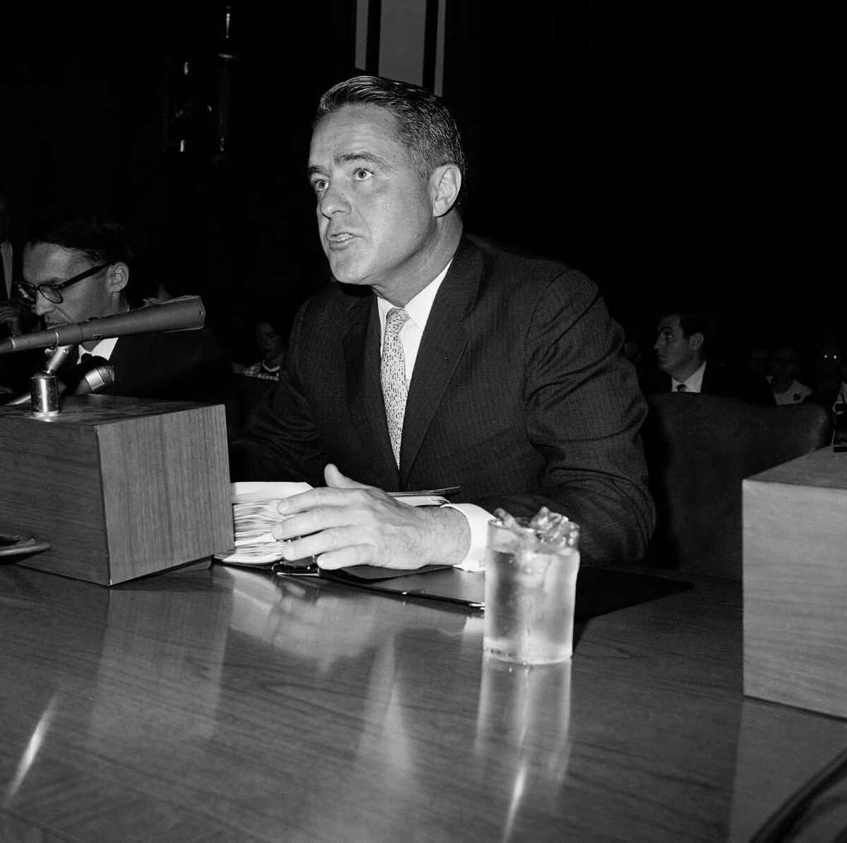 This June 9, 1965 file photo shows R. Sargent Shriver at a Senate hearing in Washington. Shriver, the exuberant public servant and Kennedy in-law whose singular career included directing the Peace Corps, fighting the