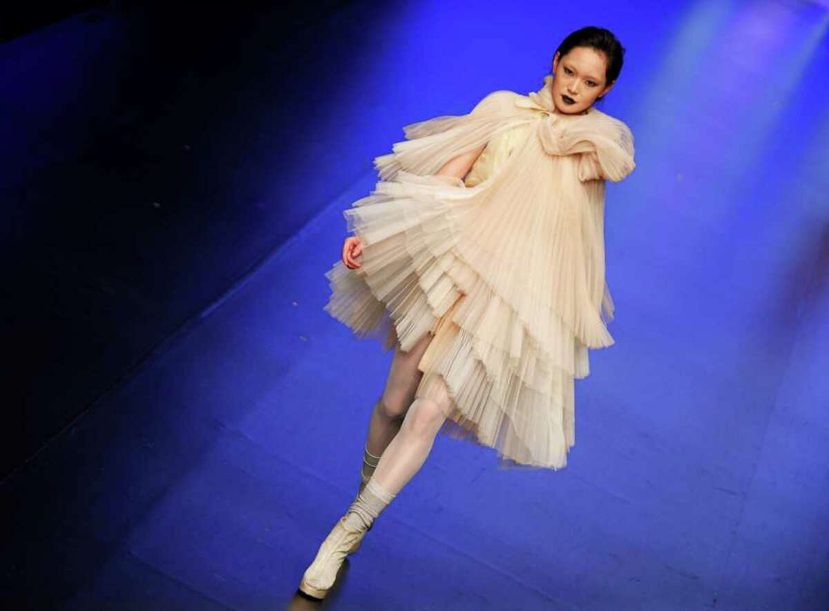A model displays a creation by Hong Kong designer Zoe Li at the Young Fashion Designers' contest in the second day of the Hong Kong Fashion Week Tuesday, Jan. 18, 2011. The Hong Kong Fashion Week features about 2000 exhibitors from 27 countries and regions. (AP Photo/Vincent Yu)