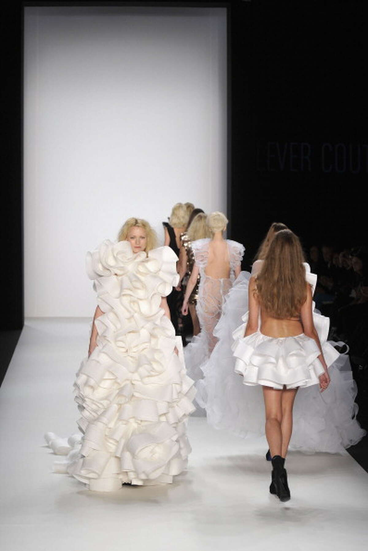 BERLIN, GERMANY - JANUARY 19: Models walk the runway at the Le Ver Couture Show during the Mercedes Benz Fashion Week Autumn/Winter 2011 at Bebelplatz on January 19, 2011 in Berlin, Germany. (Photo by Gareth Cattermole/Getty Images)