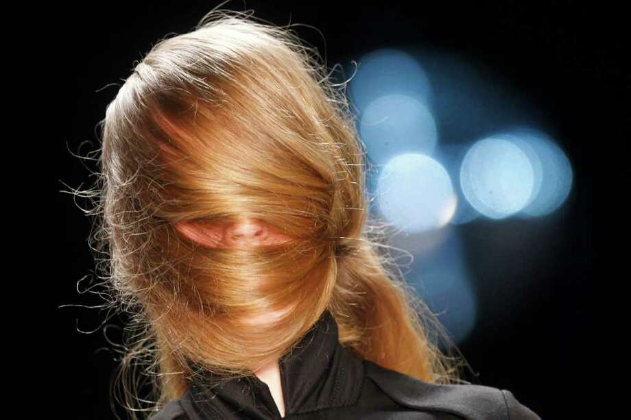 A model displays a creation of the  antum/winter collection of fashion lable A.F. Vandevorst at the Berlin Fashion Week  2011 in Berlin on Wednesday, Jan. 19, 2011.  (AP Photo/Markus Schreiber) Photo: Markus Schreiber