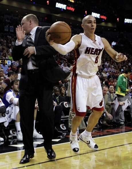 Milwaukee Bucks coach Scott Skiles, left, bumps into Miami Heat guard Carlos Arroyo (8) during the second half of an NBA basketball game in Miami, Tuesday, Jan. 4, 2011. Stiles was called for a technical foul for coming into contact with a player. The Heat defeated the Bucks 101-89. Photo: AP