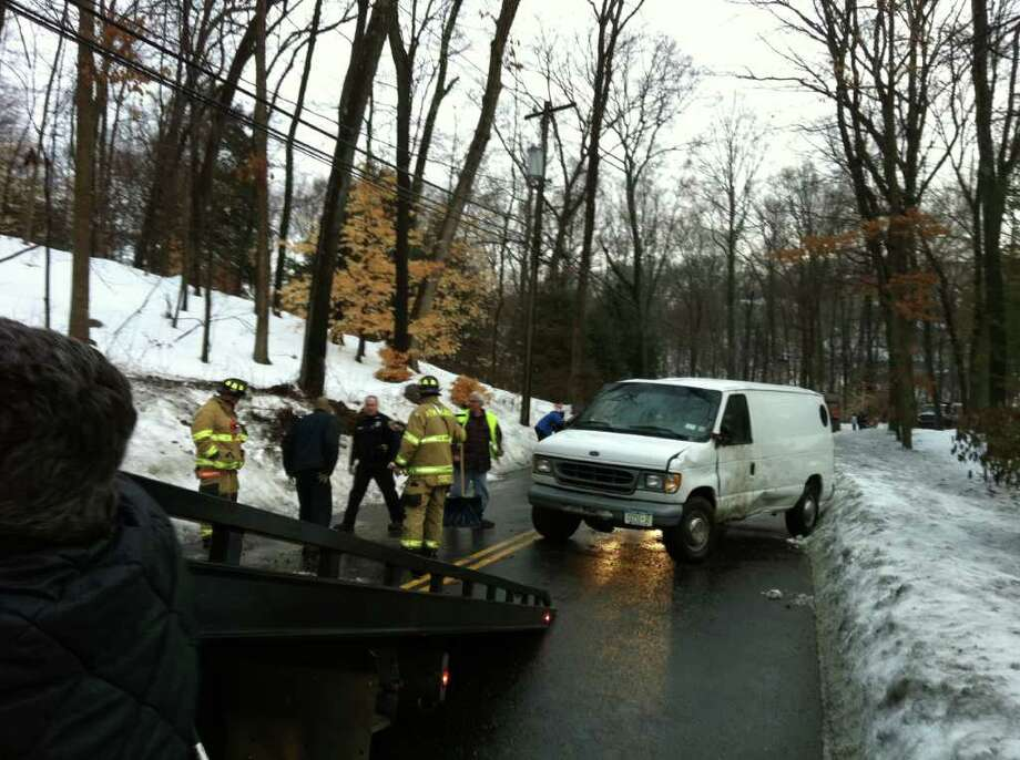 A New York man suffered minor injuries when his work van flipped over on Wahackme Road in New Canaan on Wednesday, Jan. 19, 2011 morning. Photo: John Nickerson / Stamford Advocate