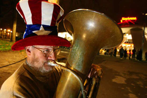 """Tuba Man"" Ed McMichael plays in front of KeyArena during a Sonics home game, Nov. 9, 2007."