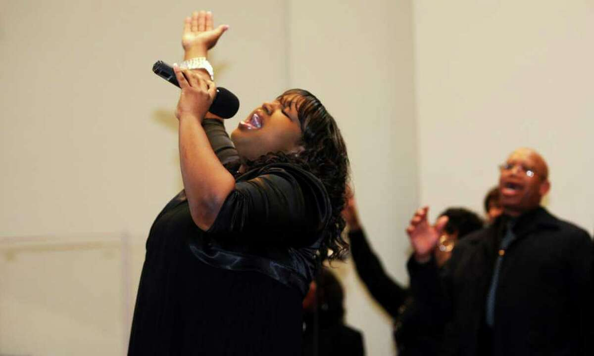 Noelle Pinyard, of the East End Baptist Tabernacle Church Mass Choir, sings during the 32nd Annual Dr. Martin Luther King, Jr. celebration at Mount Avery Baptist Church in Bridgeport on Monday, Jan. 17, 2011.