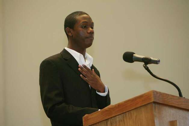 Reginald Carr gives his speech, which won the Black Pride Youth Oratorical Contest,  during the 32nd Annual Dr. Martin Luther King, Jr. celebration at Mount Avery Baptist Church in Bridgeport on Monday, Feb. 17, 2011. Photo: B.K. Angeletti / Connecticut Post