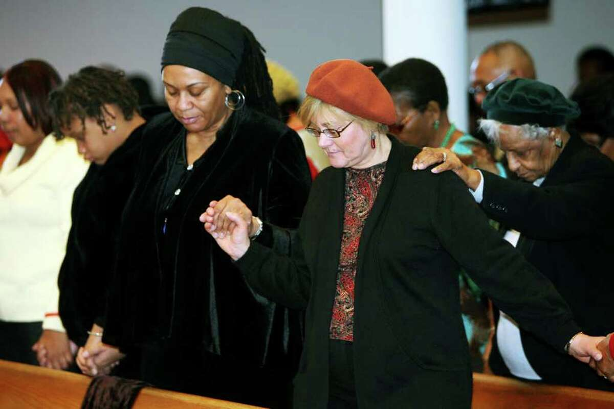 Attendees pray during the 32nd Annual Dr. Martin Luther King, Jr. celebration at Mount Avery Baptist Church in Bridgeport on Monday, Jan. 17, 2011.