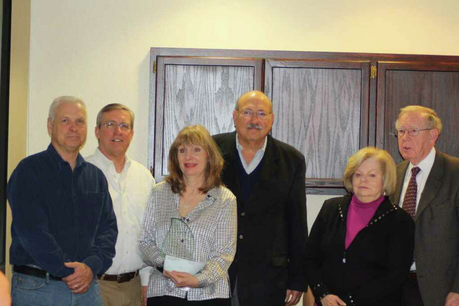The Trinity-Glen Rose Groundwater Conservation District board formally presented Brad Groves' surviving family members with a scholarship in his memory during a Jan. 13 meeting. From left are board members Harris Dickey and David Anderson, Lauren Groves (widow of Brad Groves), board President Jorge Gonzales, and Brad's parents Janie and Alvin Groves.Photo by Joni Simon Photo: Photo By Joni Simon