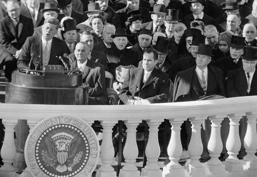 In this Jan. 20, 1961, photo, President John F. Kennedy gives his inaugural address at the Capitol in WashingtonD, D.C., after taking the oath of office Jan. 20, 1961. Listening in the front row, from left, are, incoming Vice President Lyndon Johnson, outgoing Vice president and Kennedy's defeated presidential opponent Richard M Nixon, Sen John Sparkman, D- Ala., and former President Harry Truman. Photo: Anonymous, AP / AP1961