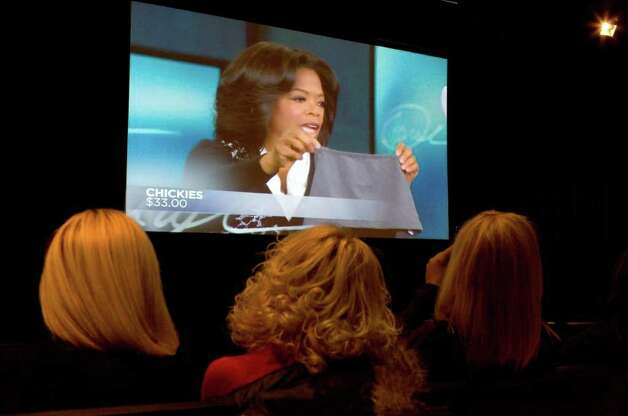 SA Life Feature/Heidbrink/Quintanilla. Guests watch Oprah Winfrey hold up a Chickie on her show during a viewing at the Pearl Studio. Chickies were invented by San Antonian Marla Ross. Photo by Jamie Karutz. Photo: Jamie Couch Karutz / San Antonio Express-News