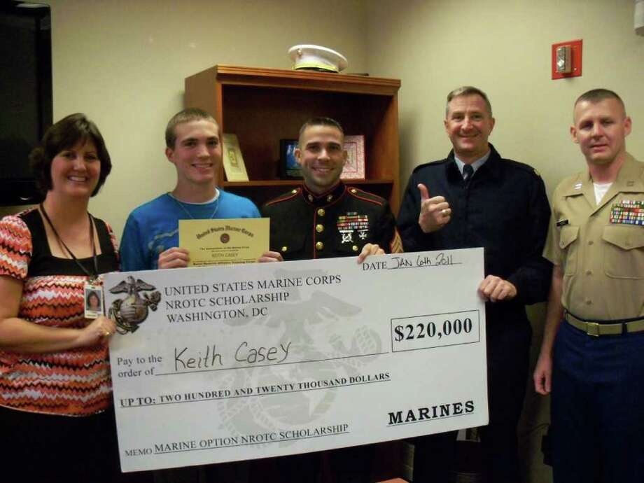 Reagan High senior Keith Casey (second from left) gets a U.S. Marine Corps NROTC Scholarship, joined (left to right) by his mother Terri, Sgt. Jason Sydebotham, Jim Casey and Capt. Jeff Horne of the San Antonio recruiting headquarters.Courtesy photo Photo: Courtesy Photo