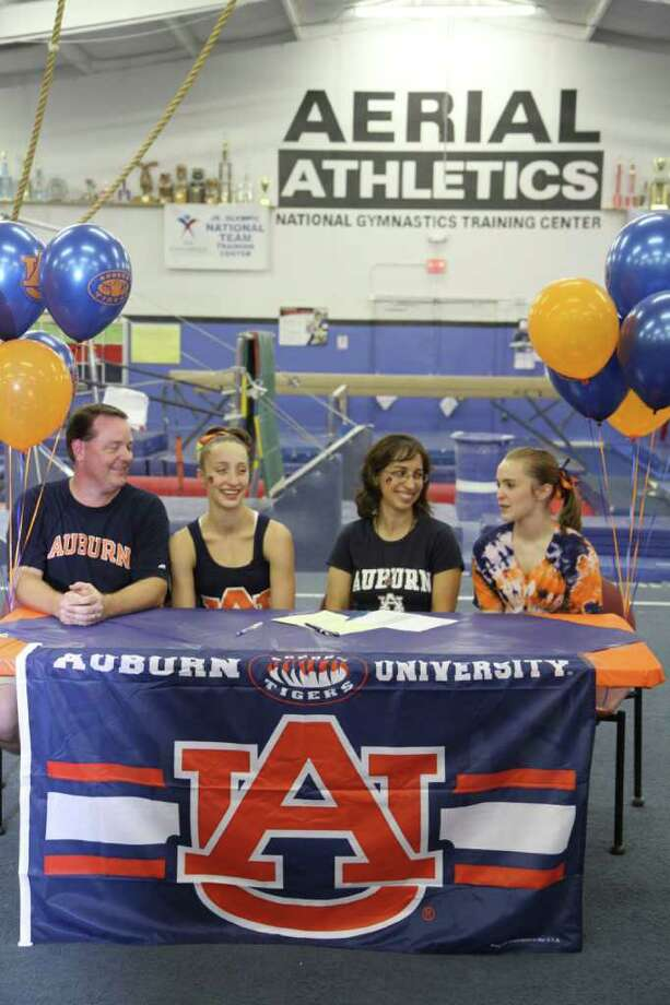 Caryn Kadous (second from left) signs her letter of intent with Auburn University Nov. 10 at Aerial Athletics, surrounded by (left to right) her parents John and Lisa, and sister Victoria.Courtesy photo Photo: Courtesy Photos