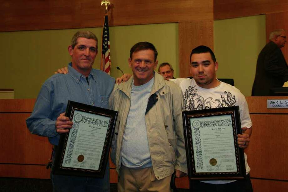 William Shahan (left) and his son, Bradley Hunt (right), stand beside Richard Eldridge during last week's Schertz City Council meeting. Shahan and Hunt were honored by the city for saving Eldridge's life during a boating accident last month.Photo courtesy of Schertz Public Information Photo: Photo Courtesy Of Schertz Public Information