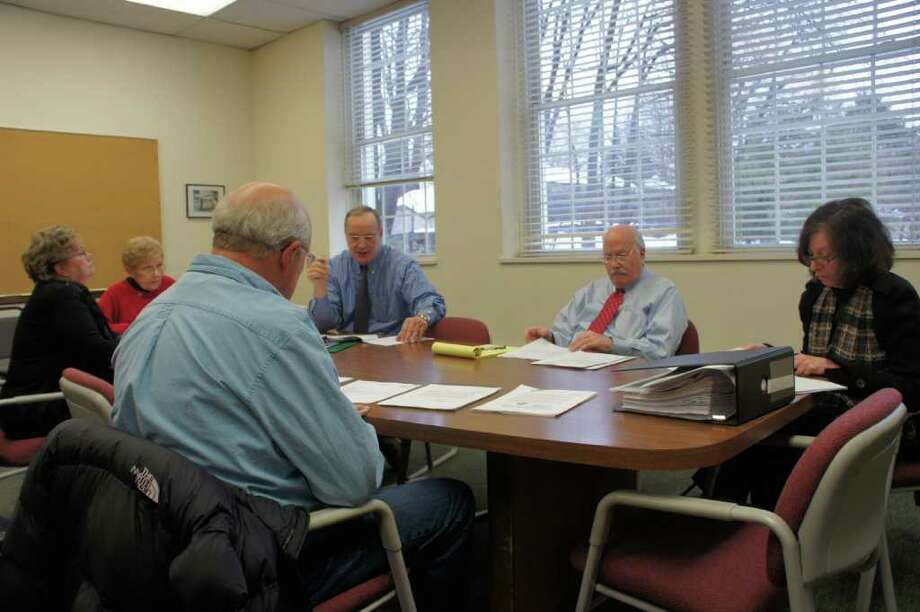 Town pension board members meet on Wednesday, Jan. 19, 2011 at Town Hall to consider a request by First Selectman Gordon Joseloff to join a town pension plan. Wearing a red tie, Joseloff sits next to Helen Garten, a pension board member who also chairs the town's Board of Finance. Photo: Paul Schott / Westport News