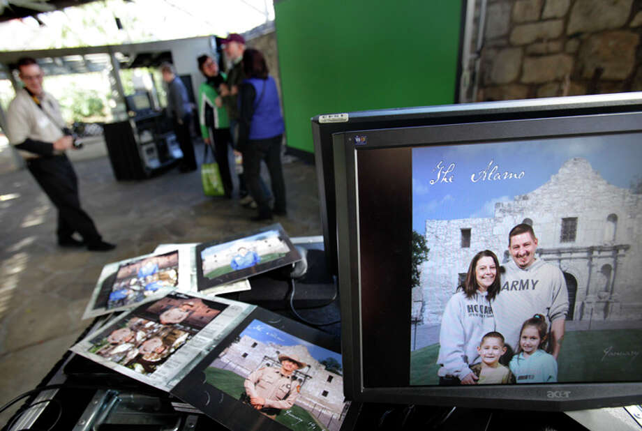 Alamo approved vendor Photogenic Inc. has set up a green screen on the grounds behind the Alamo, where tourists can be photographed and have the Alamo image placed in the background, to avoid having other people in the keepsake photo. Photo: Bob Owen / SAN ANTONIO EXPRESS-NEWS