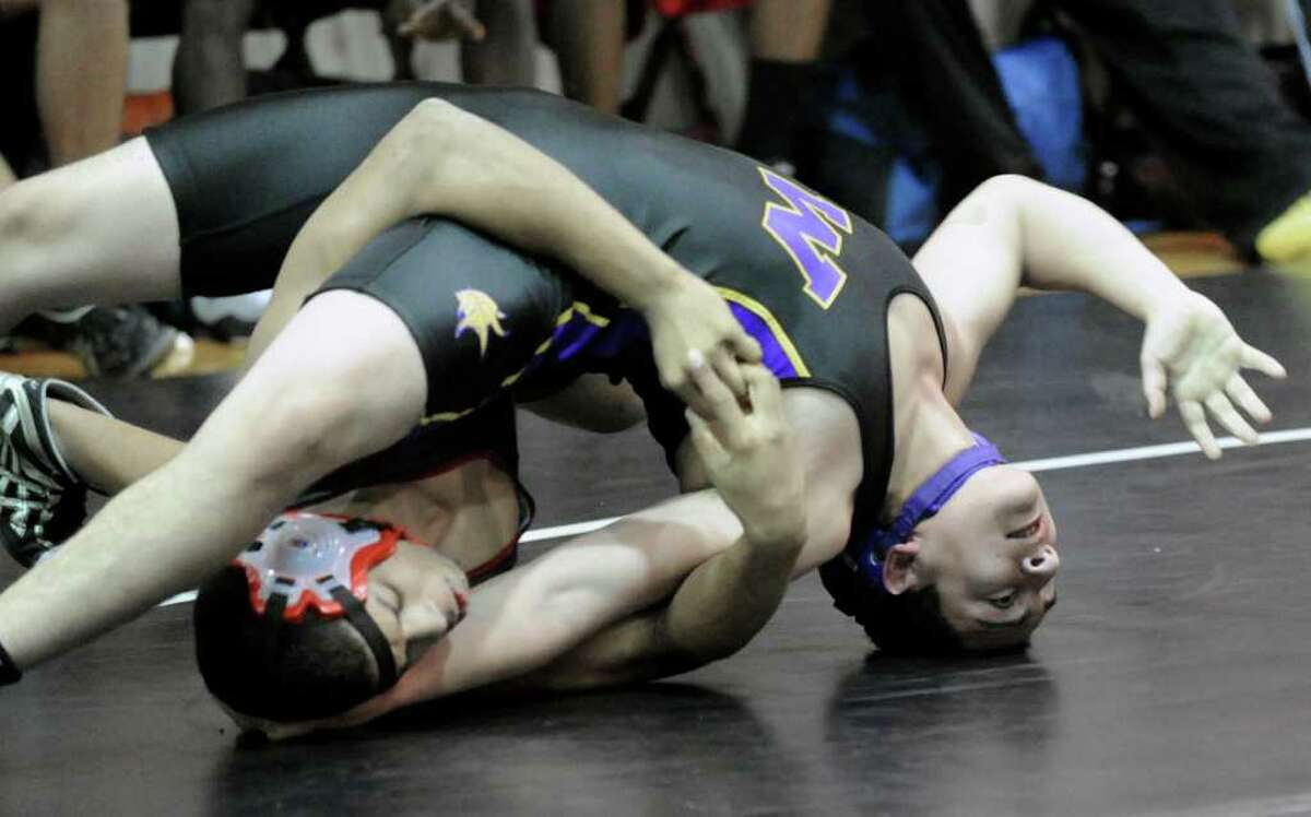 160 pound weight class, Ryan Whittle of Greenwich High School, left, takes on Carlos Alvarado of Westhill High School, right, during wrestling match between Greenwich High School and Westhill High School, at Greenwich High School, Wednesday afternoon, Jan. 19, 2011.