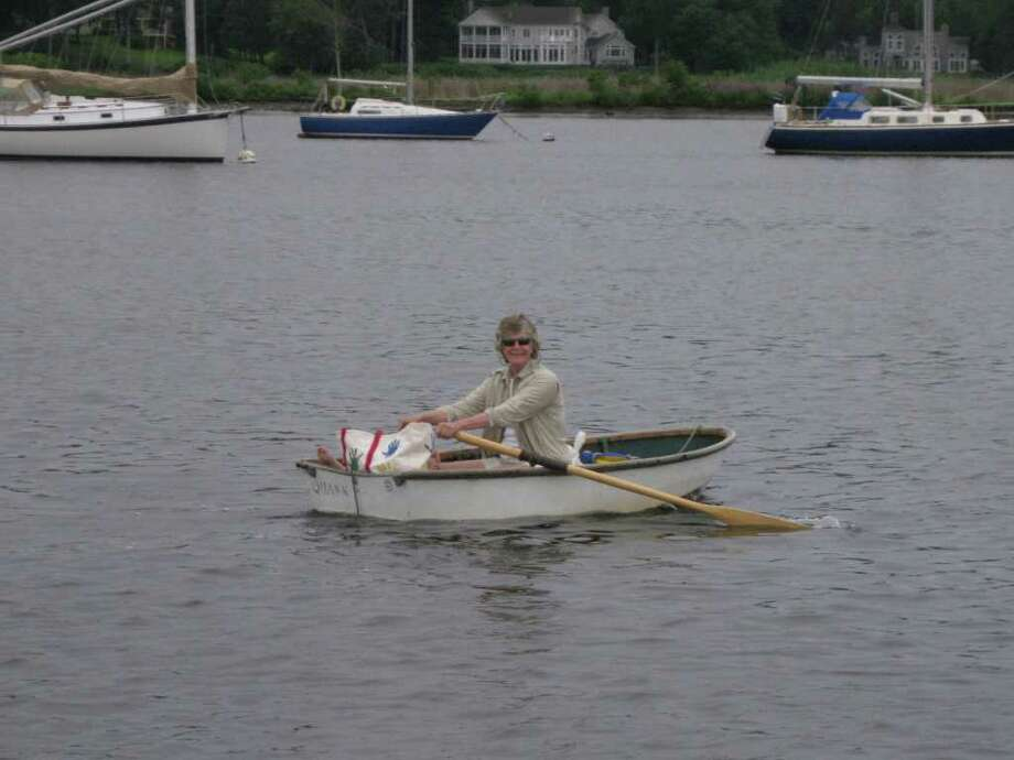 Susan Huntington Fisher, shown here in a rowboat, will become the first female commodore of the Indian Harbor Yacht Club. Photo: Contributed Photo / Greenwich Time Contributed