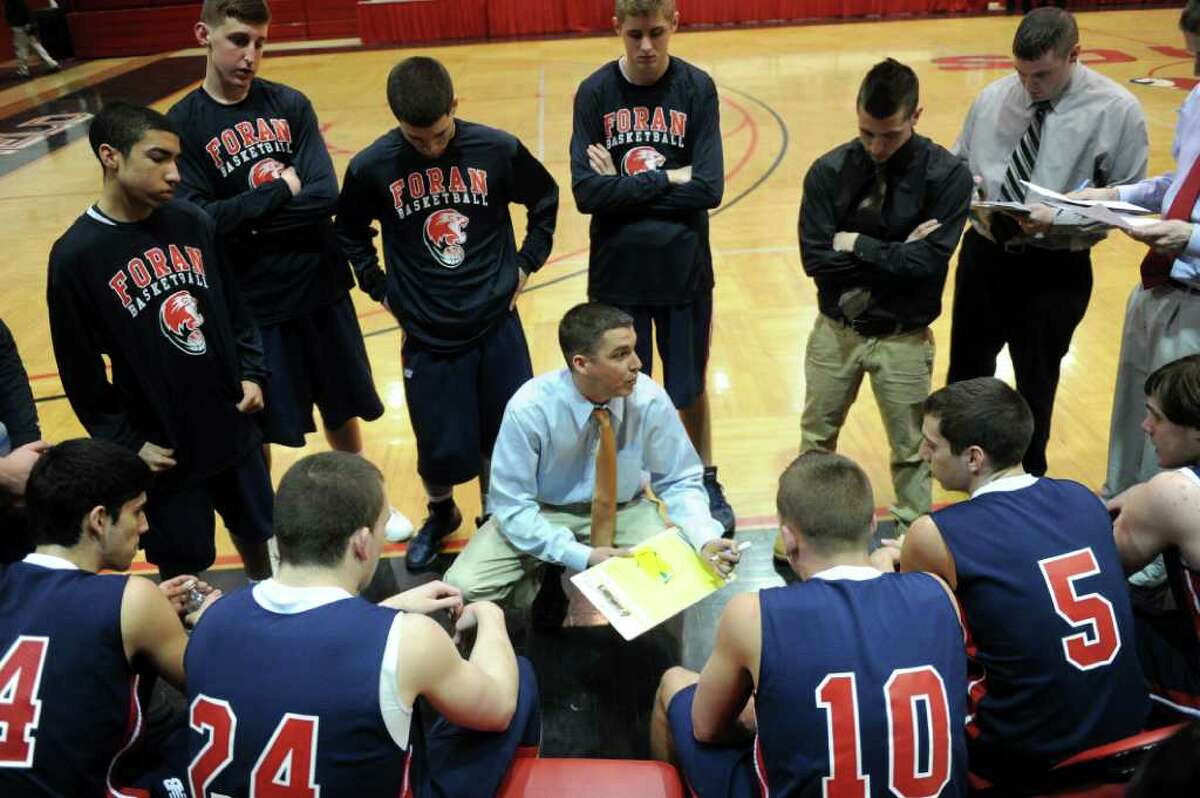 Foran's coach Tim Swaller talks to his team between quarters of Wednesday's game against Fairfield Prep at Fairfield University on January 19, 2011.