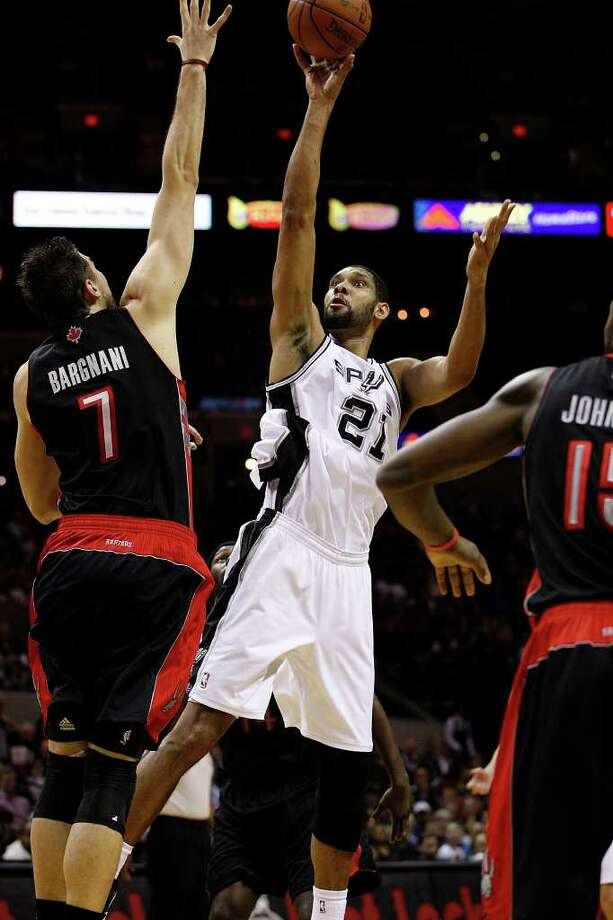 SPURS -- San Antonio Spurs Tim Duncan shoots over Toronto Raptors Andrea Bargnani during the first half at the AT&T Center, Wednesday, Jan. 19, 2011. JERRY LARA/glara@express-news.net Photo: JERRY LARA, San Antonio Express-News / glara@express-news.net