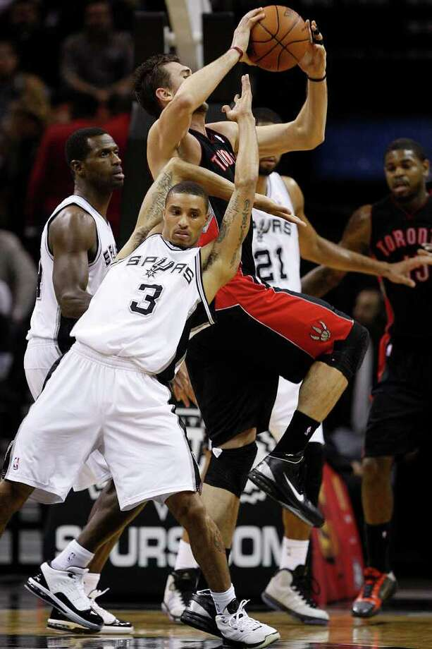 SPURS -- San Antonio Spurs George Hill fouls Toronto Raptors Andrea Bargnani during the first half at the AT&T Center, Wednesday, Jan. 19, 2011. JERRY LARA/glara@express-news.net Photo: JERRY LARA, San Antonio Express-News / glara@express-news.net