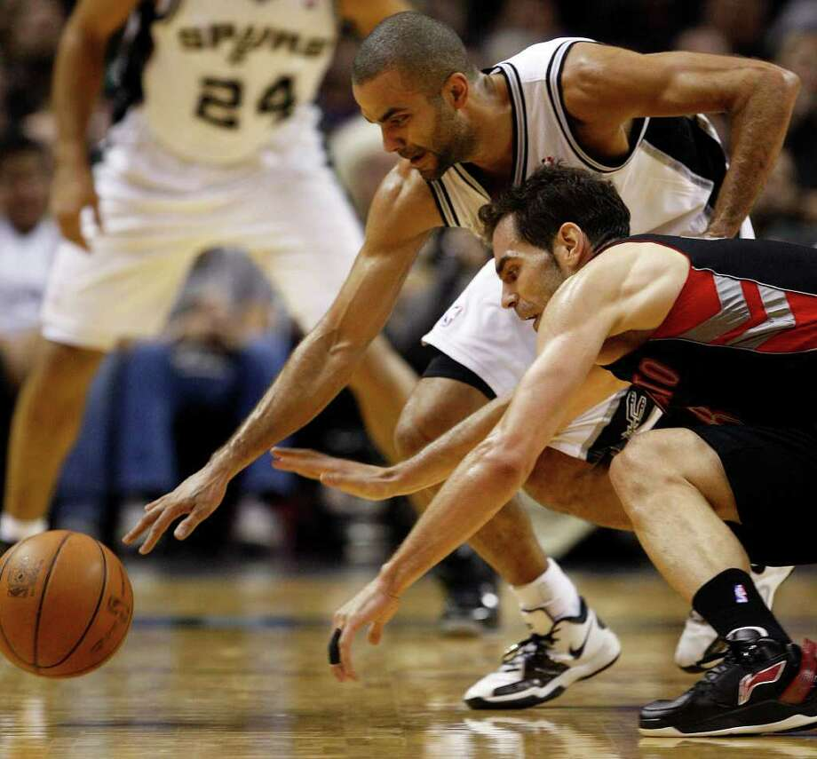 SPURS -- San Antonio Spurs Tony Parker steals the ball from Toronto Raptors Jose Calderon during the second half at the AT&T Center, Wednesday, Jan. 19, 2011. The Spur won 104-95 and improve to 36-6. JERRY LARA/glara@express-news.net Photo: JERRY LARA, San Antonio Express-News / glara@express-news.net